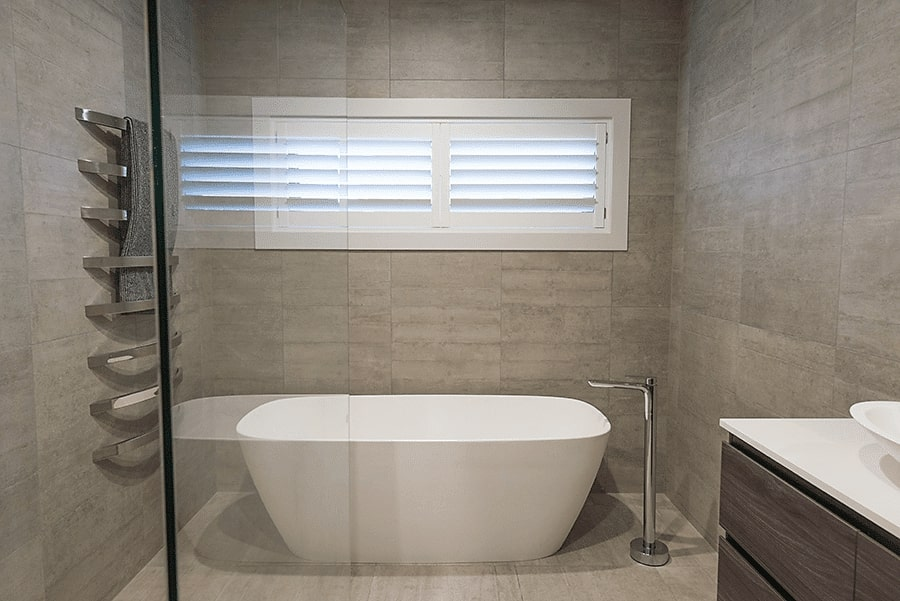 White bathtub gray walls gungahlin job
